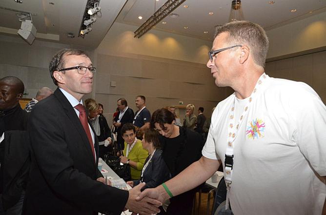 Espen Barth Eide og Lars Børseth på innvandrerkonferansen 2013.